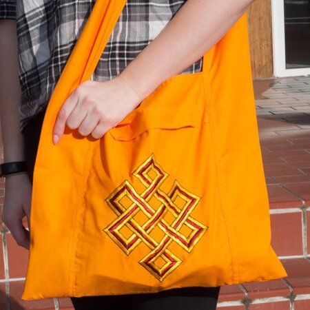 Lama Tasche orange Motiv Endloser Knoten